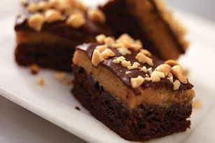 Triple-Layer Peanut Butter Brownies    1pkg.  (19 to 21 oz.) brownie mix (13x9-inch pan size)  1pkg.  (3.4 oz.) JELL-O Vanilla Flavor Instant Pudding  1cup  cold milk  1cup  PLANTERS Creamy Peanut Butter  1/2cup  powdered sugar  1-1/2cups  COOL WHIP Whipped Topping (Do not thaw.)  3oz.  BAKER'S Semi-Sweet Chocolate  1/2cup  PLANTERS Dry Roasted Peanuts, coarsely chopped