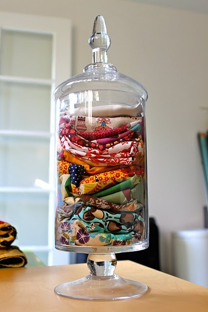 love this decorative way to store extra fabric scraps
