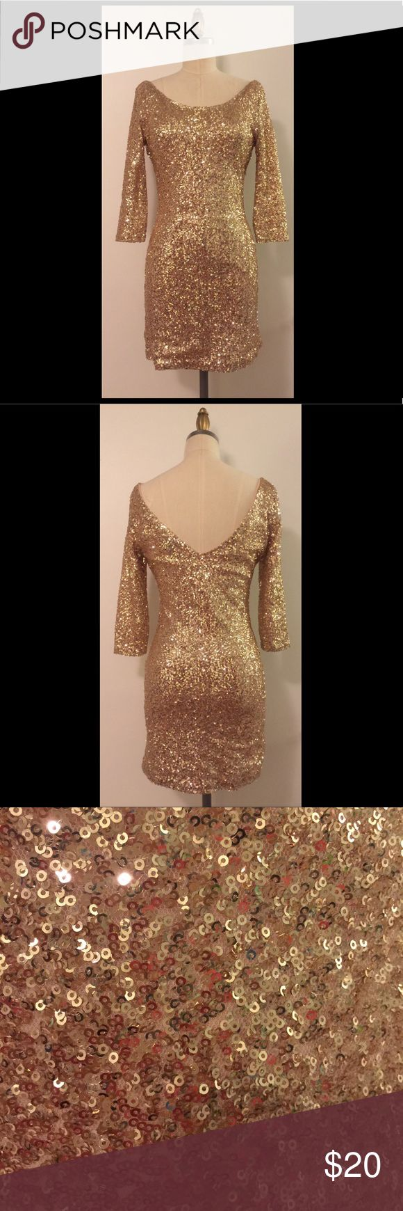 Long sleeve gold sequin dress Long sleeve gold sequin dress with high scoop neckline on the front and a low v-neckline in the back. Mini skirt length but still long enough to sit comfortably in!! Perfect for New Years or a holiday party! Has a side zipper to help you shimmy into this sparkling number!!! Forever 21 Dresses Long Sleeve