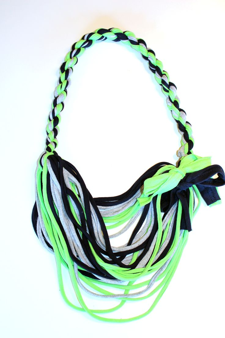 A scarf with a twist! Why not add a feminine touch to your Seahawks Super Bowl Gear? Fun twisted t-shirt scarfwith adjustable strands on the bottom. Give them a tug and shift them around to give it a staggered effect and change up the look a bit. It measures approx. 21 inches in length.