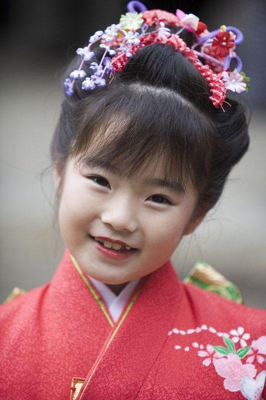 In special kimono at her Shichigosan coming of age day.  Shichigosan, Kasuga Shrine, Nara, Japan.  Photography by Jon Bower