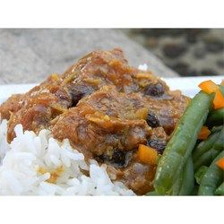 Boneless pork loin slowly cooks in a curried fruit sauce until tender and delicious.