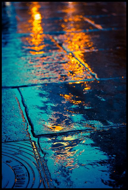 Reflections. Reminds of the way the traffic lights reflect on asphalt when it rains. . .so beautifully. . .