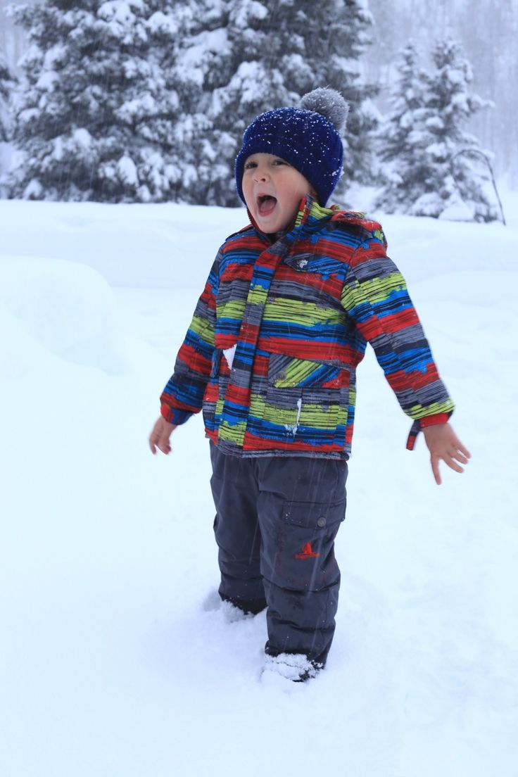 happy child playing in the snow winter snow days