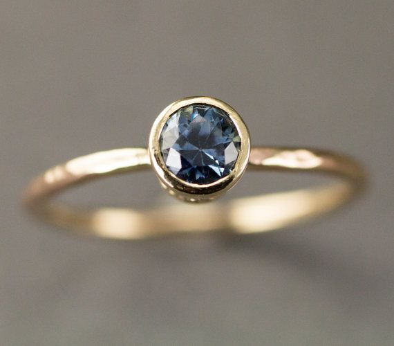This minimalist 14k gold Montana Sapphire gold engagement ring features a genuine .67 carat lovely medium blue Montana yogo sapphire set in a solid heavy