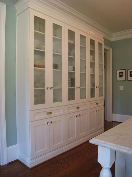 beautiful built in - with stock cabinets--look awesome on back wall of craft room/mudroom for extra storage