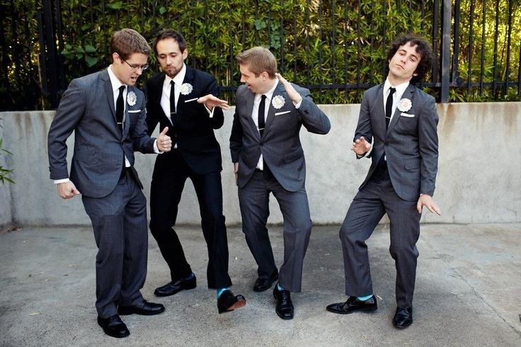 a.) I like how formal and uniform the look is despite it being suites  b.) black vs. charcoal/grey a good way to differentiate between groom and groomsmen  c.) our guys will prob have a similar picture  Suites by Thick as Thieves