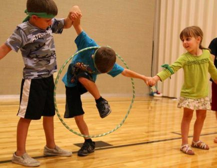 Hoop relay - While holding hands, try to move the hula hoop up and down the line. Team event