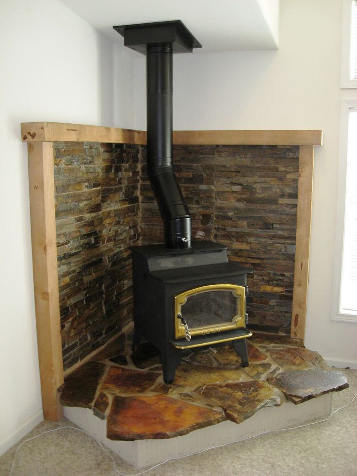 Corner Wood Stove Hearths | This Wood Stove Was Installed In The Corner Of  A Large