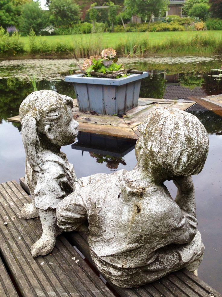 Boy and girl enjoying the beautiful garden
