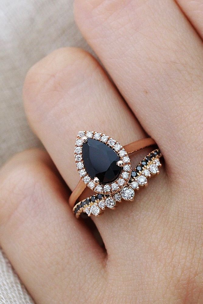 24 Unique Black Diamond Engagement Rings ❤ black diamond engagement rings pear cut wedding set halo rose gold ❤ More on the blog: https://ohsoperfectproposal.com/black-diamond-engagement-rings/ #ringly #diamondhalorings #halorings