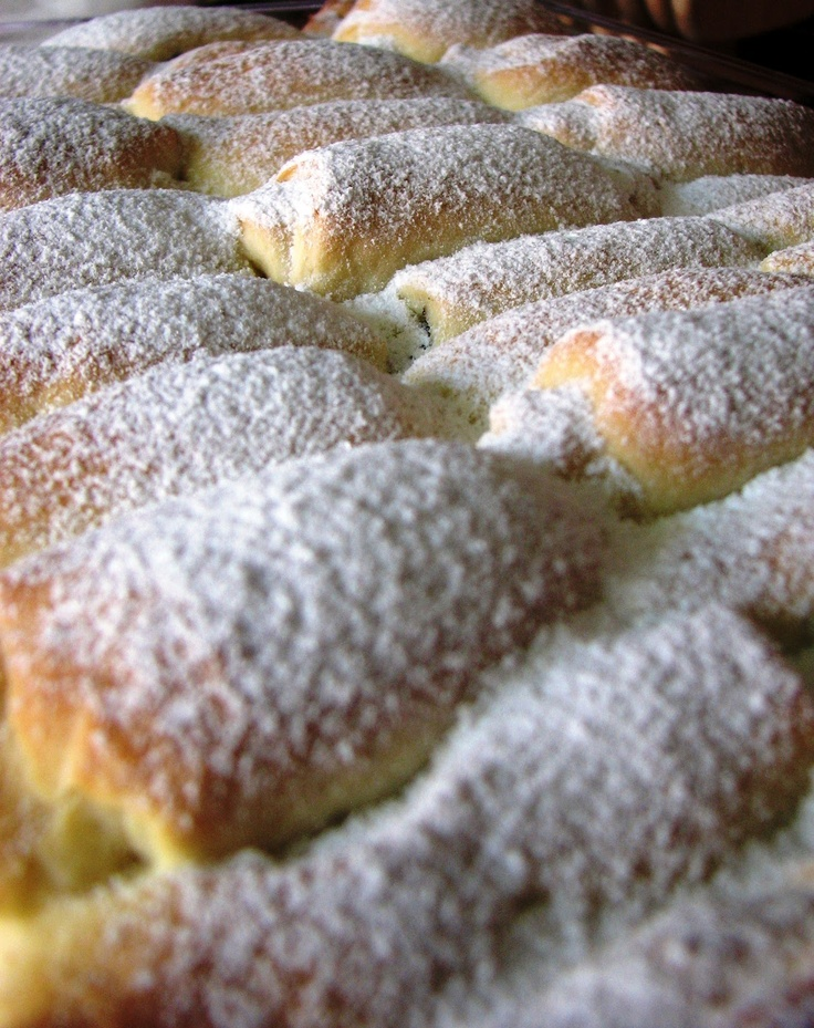 Pečené buchty are tasty baked buns filled with a sweet surprise. It may be plum jam (slivkovký lekvár), farmer's cheese (tvaroh), poppy seeds (mak) or even walnuts (orechy).
