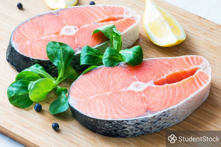 "StudentStock - ""Fresh, raw salmon steaks on wooden board"" by Vladislav Nosick"