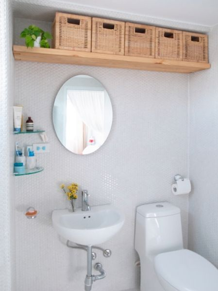baskets are perfect to store things in a bathroom - Shelterness