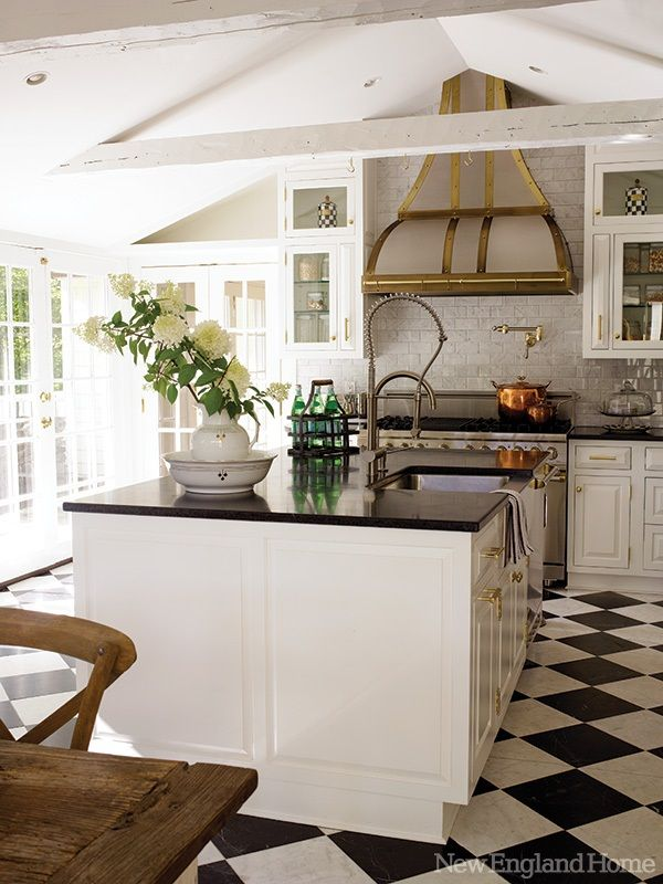 Gray walls, white cabinets, and black counter tops.
