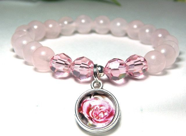 Pale pink rose quartz gemstone bracelet is made with 8mm Rose Quartz, Pink Swarovski crystals and features a beautiful handmade cabochon Rose Charm. So sweet and simple. Rose Quartz Properties: Known