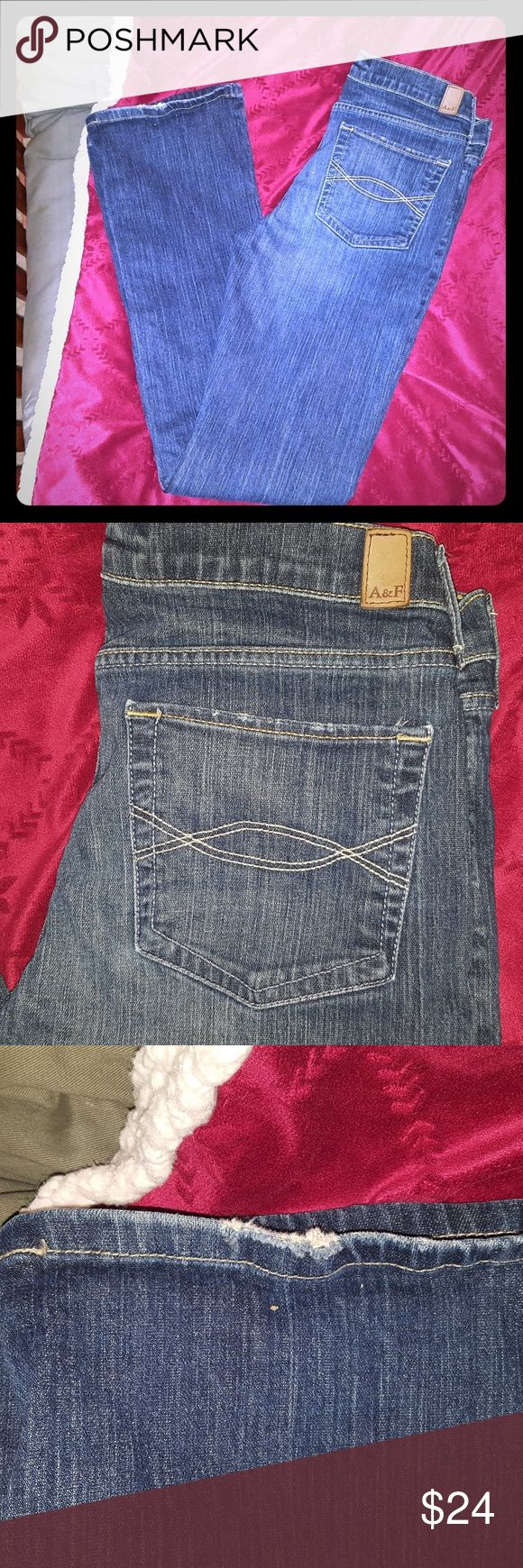 ABERCROMBIE AND FITCH JEANS These vintage darker denim jeans have a slight distressed look on the bottom of the leg on the him and also on the back pockets. The inseam is 33 inches. They are stretch jeans and the style is Emma. Abercrombie & Fitch Jeans Boot Cut