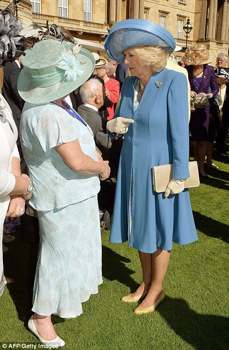 Camilla, Duchess of Cornwall meets guests on the lawn.