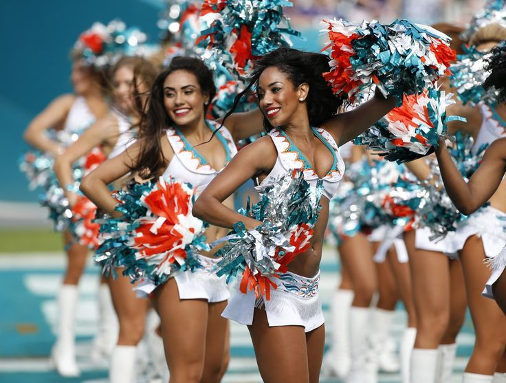 Miami cheerleaders perform during the first half of an NFL football gam against the Baltimore Ravens, Sunday, Dec. 6, 2015, in Miami Gardens, Fla. (AP Photo/Wilfredo Lee)