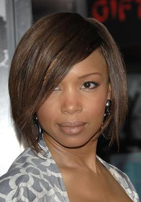This cut is super flattering on a round face. What's more, it will grow out beautifully. The key to short hair is to keep it straight so it doesn't add body (and volume) to the sides of the face.