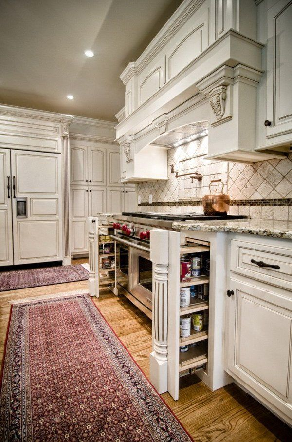 i like the slender pull outs on each side of the stove..perfect for spices and such