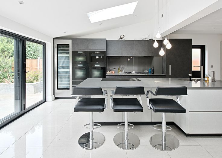 Monica Galetti's kitchen is a sleek example of contemporary kitchen design, featuring a large central island, a bank of Miele ovens and a flush fit Miele induction hob