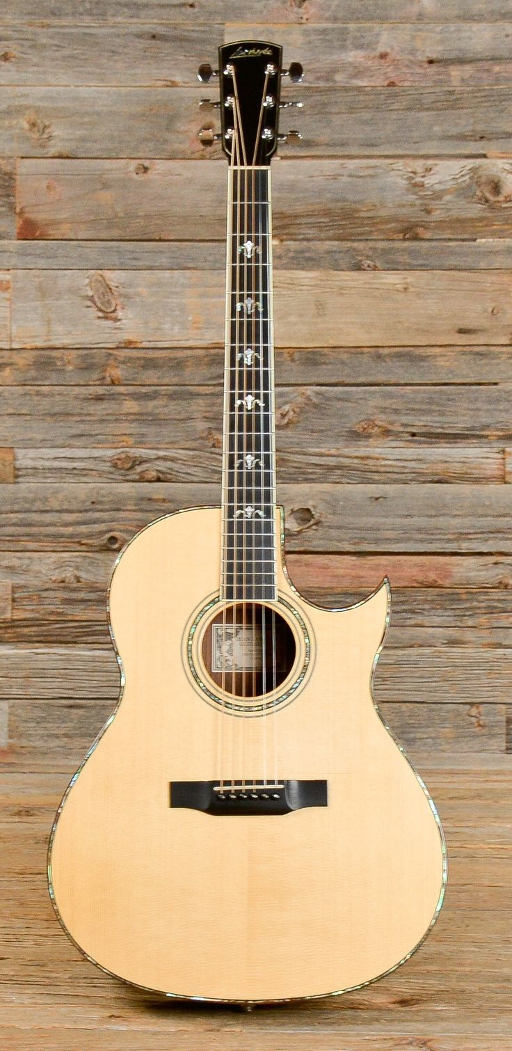 Larrivee C10e.  My first high end guitar.   Gigged with this for years Witt the Mazik Bros Band when we were all acoustic.