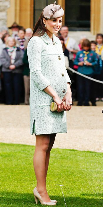 The Duchess' bump finally debuts in this mint green Mulberry coat for a parade in London in April.
