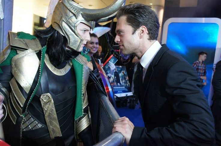 Sebastian Stan With Someone In Loki Cosplay And A Fan In