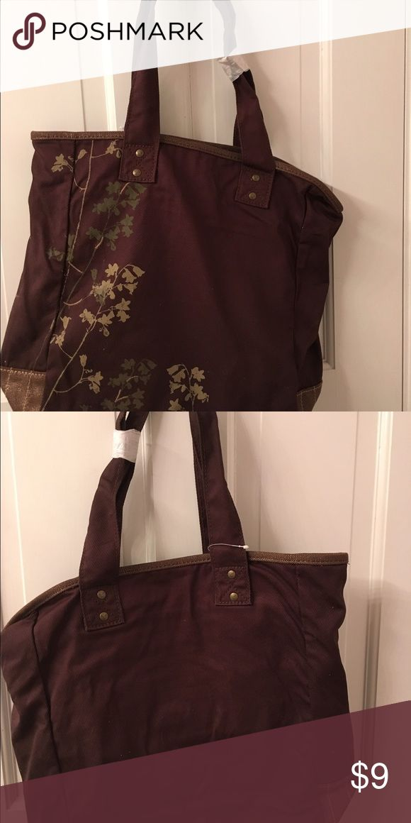 American Eagle Brown Canvas Bag Roomy American Eagle brown canvas bag. Brand new.  Small zippered compartment inside which a cell phone can fit into. Two handles. American Eagle Outfitters Bags Totes
