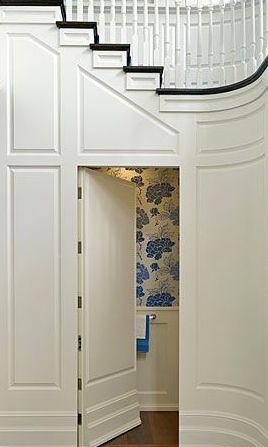 Hidden door with large scale wall paper in powder room