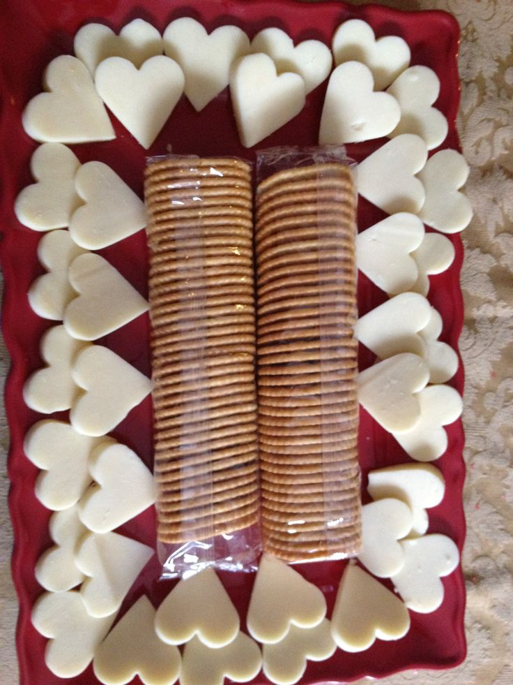 Healthy Valentine Snacks - whole grain crackers with heart shaped cheese cutouts.