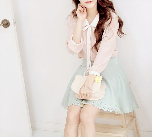 A cute and casual outfit with the white collared blouse with the pastel mint green skirt and the white clutch.