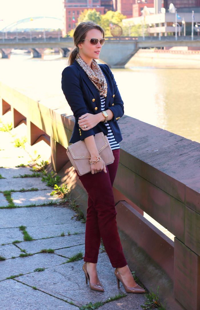 Maroon skinny jeans, navy striped top, navy jacket, gold and bone accessories
