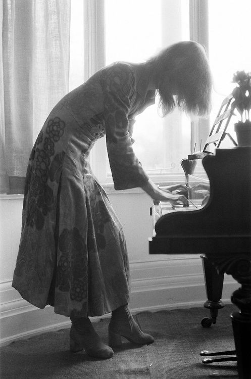 David Bowie playing the piano at home, 1971