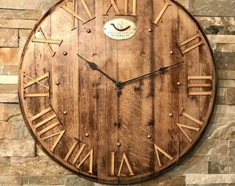 A red wine barrel lid clock made from a retired Tonnellerie Cooperage barrel lid, Napa Valley, USA.