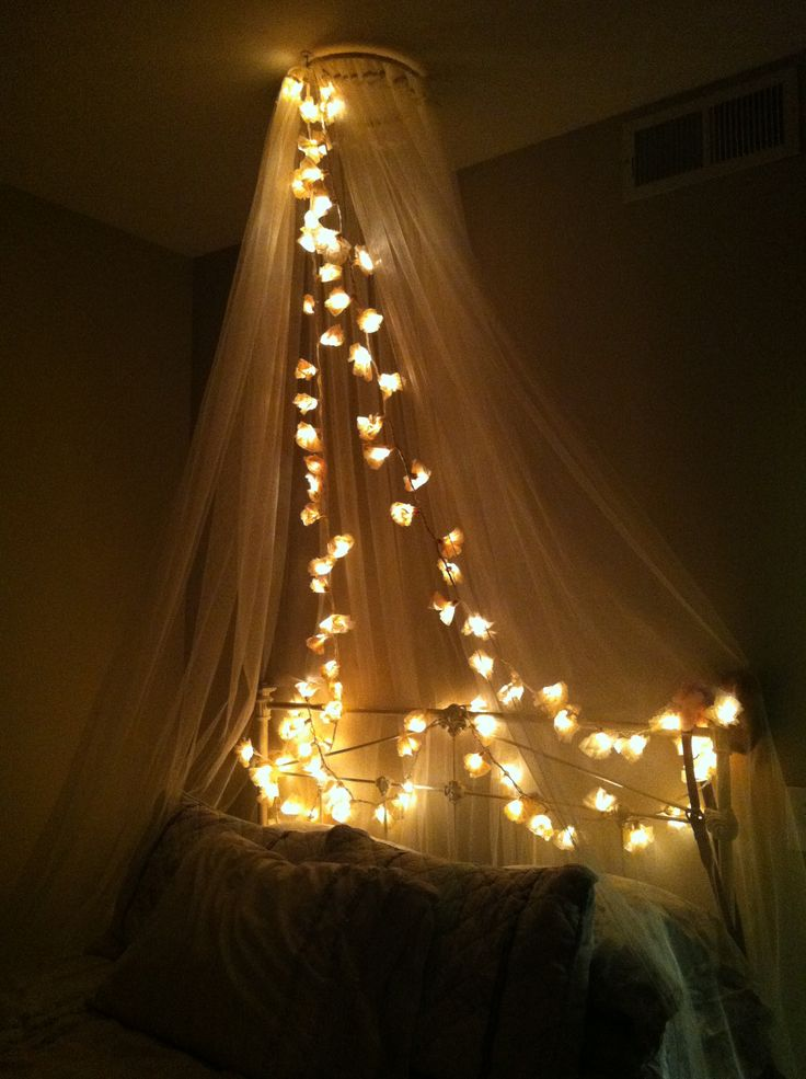 Homemade canopy w/ Ikea curtains and embroidery hoop, coffee filter flower lights
