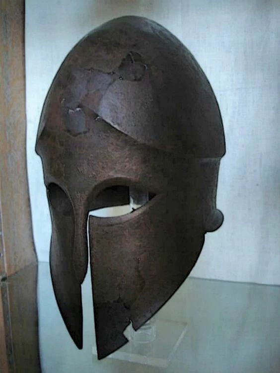 A Corinthian helmet which has suffered the ravages of war is on display at the National Archaeological Museum in Athens