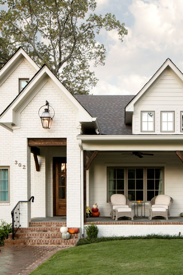 Beautiful white farmhouse exterior! Paint color: S…