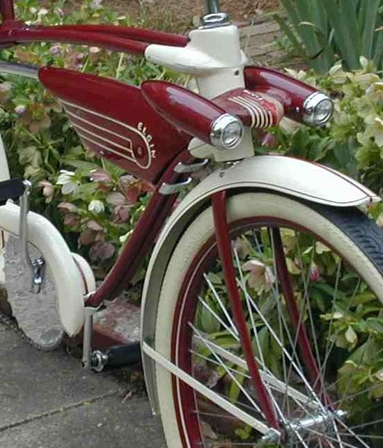 Beautiful 50's style bicycle, twin headlights, two tone paint work and classic white wall tyres.