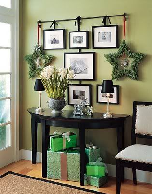 Curtain rod, ribbon and photos.