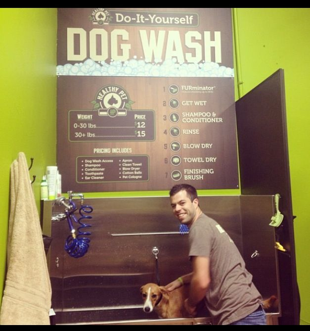 #HealthyPet owner Trevor scrubs up a pup in the store's dog wash.