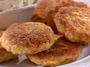 Fried Salmon Patties (Amish recipe) 2 C. cracker crumbs, 1 C. Salmon, 1 onion,1 tsp salt, 2 eggs (beaten), 1 1/2 C. milk, pepper to taste. mix together and form into patties. Sprinkle both sides with cornmeal/flour mix. Fry. This is a delicious recipe!
