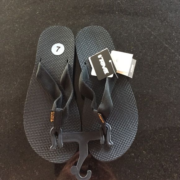 New Teva flip flops Teva black flip flops, size 7.  Arch support.  New with tag attached. Teva Shoes Sandals