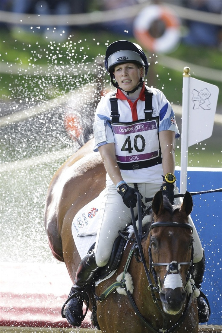 Zara Phillips of Great Britain rides Kingdom as she competes in the equestrian eventing cross-country phase at Greenwich Park July 30.