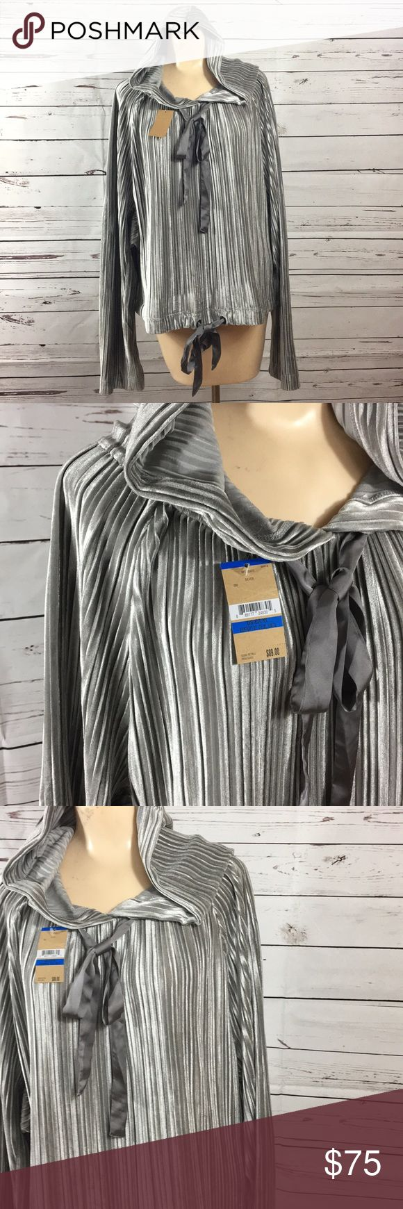 """🆕 Rachel Roy silver hoodie Silver velvet Rachel Roy silver hoodie. I mean come on. Gorgeous! Ties as neck and hem. Super stretch and so stylish! Who says staying warm can't look good? Slight dolman sleeve for even more comfort.   24"""" pit to pit.  25"""" shoulder to hem. Rachel Roy Tops Sweatshirts & Hoodies"""