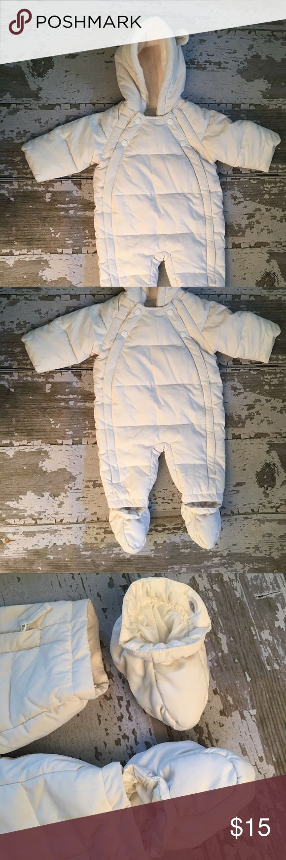 Marks & Spencer Baby Snowsuit Marks & Spencer Snowsuits  Size: please see picture for size  Color: cream/ivory  In gently used condition. Comes with detachable booties. Button and zipper Front Opening. Very Soft. marks & spencer Jackets & Coats