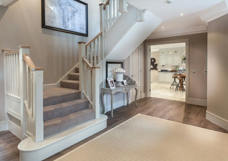 Interior Designed Hallway / Entrance Hall. Beautiful, classical hallway designed with a French feel. Dark wood floors and french painted console table with mink coloured carpet. For Millgate Homes by Alexander James Interiors {Photo Courtesy of www.aji.co.uk }