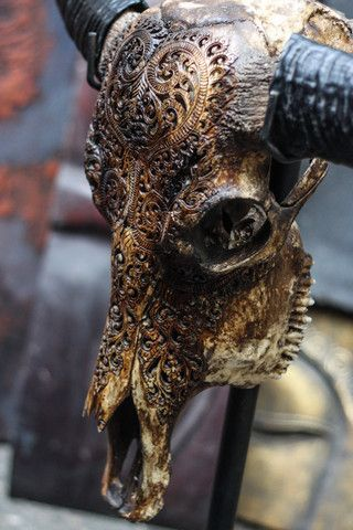 Buffalo Skull - Antique Heart Carving  Numerous details were added to this stunning bull horn skull to make it a true masterpiece.