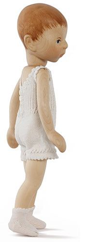 A basic hand-carved wooden boy doll in his knit underwear and socks, 2011, Germany, by Elisabeth Pongratz.